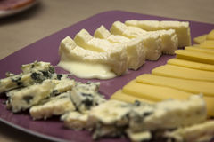 Several different French cheeses on a plate Royalty Free Stock Images