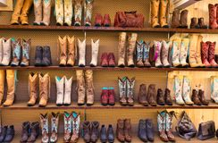 Cowboy boots on a shelf in a store, front view. Several different ornate cowboy boots on a shelf in a store Royalty Free Stock Images