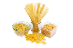Several different uncooked pasta on a light background Stock Photos