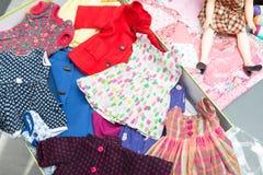 Several doll clothes Stock Photos