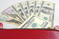 Several dollar bills in a red purse Royalty Free Stock Photos