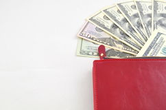 Several dollar bills in a red purse Stock Photography