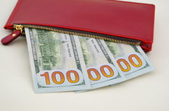 Several dollar bills in a red purse Stock Photo