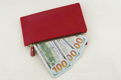 Several dollar bills in a red purse Royalty Free Stock Photo
