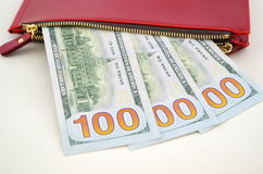 Several dollar bills in a red purse Stock Image