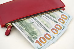 Several dollar bills in a red purse Stock Images