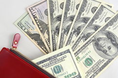 Several dollar bills in a red purse Stock Photos