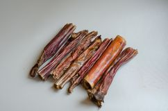 A small handful of bully sticks on a light background. Natural treats for dogs. Air dried chew. Dried beef royalty free stock photography