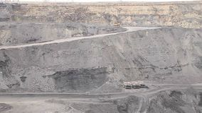 Several dump trucks in coal open pit. Several dump trucks coal open pit stock video