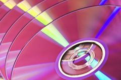 Several DVD discs in pink tint Royalty Free Stock Image