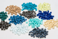 Several dyed polymer resins. Different dyed polymer pellets on white royalty free stock photo
