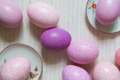 Easter eggs on the table cloth colored and tinted, top view. Several Easter eggs on the striped linen table cloth, colored and tinted Royalty Free Stock Images