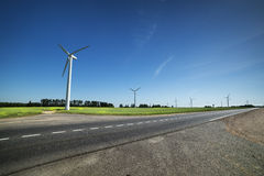 Several eco-friendly wind turbines Royalty Free Stock Photos