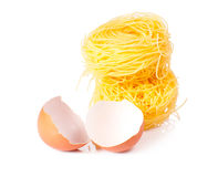 Several eggs and pasta on a white Royalty Free Stock Photos