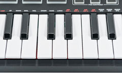 Several electric piano keys. Keys black electric piano with control buttons, close-up Stock Images