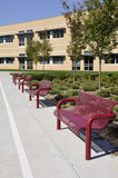 Several empty outdoor benches. By an elementary school building in Whitehall, Pennsylvania royalty free stock image