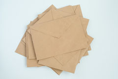 Several envelopes from brown letter paper, on white background close-up, top view royalty free stock photography