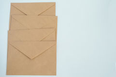 Several envelopes from brown letter paper, on white background close-up, top view Stock Photos