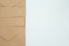 Several envelopes from brown letter paper, on white background close-up, top view Royalty Free Stock Images