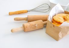 Several equipment or tools for bakery cooking including rolling pin, whisk and bowl or cup, all are put on white table royalty free stock photos