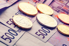 Several 500 euro banknotes and coins are adjacent. Symbolic photo for wealth. Royalty Free Stock Images