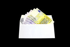 Several Euro banknotes in a white envelope. On a black background Stock Image