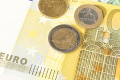 Several Euro coins on the background of Euro banknotes. The concept of savings.  stock image