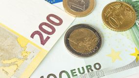 Several Euro coins on the background of Euro banknotes. The concept of savings.  royalty free stock images