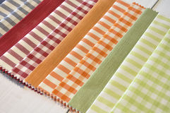 Several fabrics of different patterns and colors Stock Images