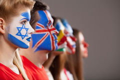 Several faces painted. Different countries face art in profile Royalty Free Stock Photography