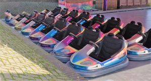 Several fairground ride bumper cars in multiple colors royalty free stock images