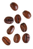 Several falling roasted coffee beans Stock Photos