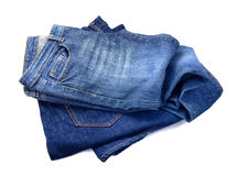 Several fashion blue jeans isolated on white background. Several fashion blue jeans isolated on white royalty free stock image