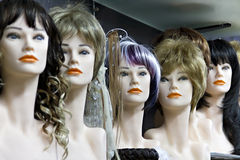 Several female mannequins with wigs. On the shelf Stock Photos