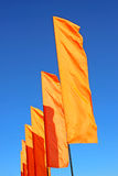 Several festive orange flags Royalty Free Stock Photo