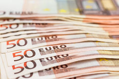 Several fifty euro banknotes stacked. Euro money concept. Selective focus Royalty Free Stock Images