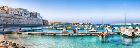 Several fishing boats at the Otranto harbour - coastal town in Puglia with turquoise sea. Italian vacation. Town Otranto, province of Lecce in the Salento royalty free stock photos