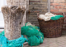 Several fishing net and basket. On the floor Stock Image