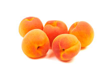 Several five group ripe orange apricots, peaches isolated on whi. Te background Royalty Free Stock Image