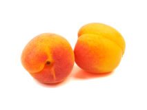 Several five group ripe orange apricots, peaches isolated on whi Royalty Free Stock Images