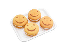 Several flaky cookies with the image of smiling face Stock Photo