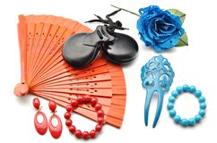 Several flamenco ornaments. Flamenco ornaments consisting of fans, castanets, a comb and a blue flower surrounded by white background Royalty Free Stock Images