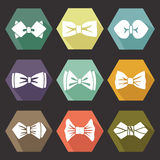 Several flat icons with white silhouettes of bow tie Royalty Free Stock Photo