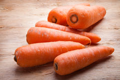 Carrots on wood Royalty Free Stock Images