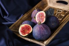 Figs in wooden bowl Royalty Free Stock Image