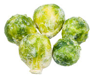 Several frozen Brussels sprouts isolated on white Stock Photos
