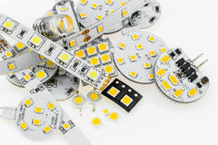 Several G4 LED bulbs with different electronics and LED strips a Stock Photos