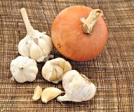 Several garlic and onion Royalty Free Stock Photos