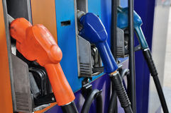 Several gasoline pump nozzles at petrol station Royalty Free Stock Photo