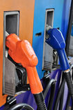 Several gasoline pump nozzles at petrol station Royalty Free Stock Images